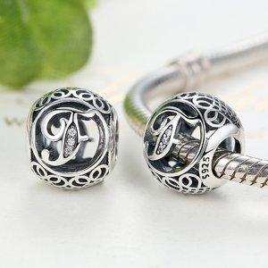 Talisman din argint cu litera F